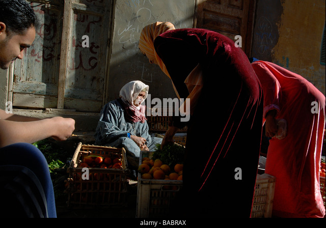 A woman cured from leprosy is now selling fruits and vegetables in order make a living - Stock Image