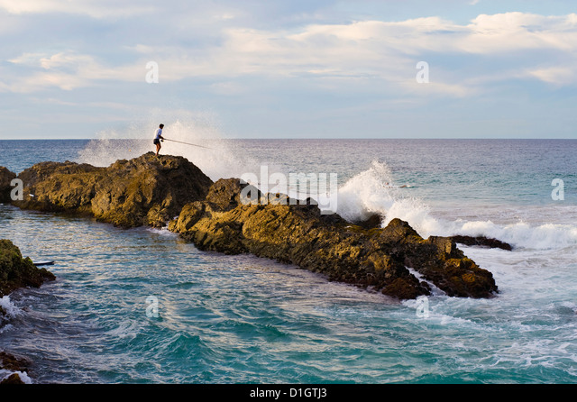Fisherman getting hit by a wave while rock fishing at Snapper Rocks, Tweed Heads, Gold Coast, Queensland, Australia, - Stock-Bilder