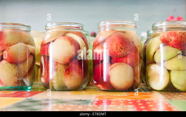 Jars of homemade fruit preserves - vintage photo - Stock Image
