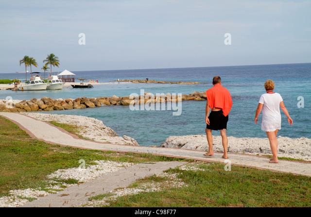 Curaçao Netherlands Antilles Dutch Piscadera Bay Hilton Curaçao hotel resort Caribbean Sea woman man couple - Stock Image