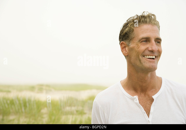 Close-up of a mature man smiling - Stock Image