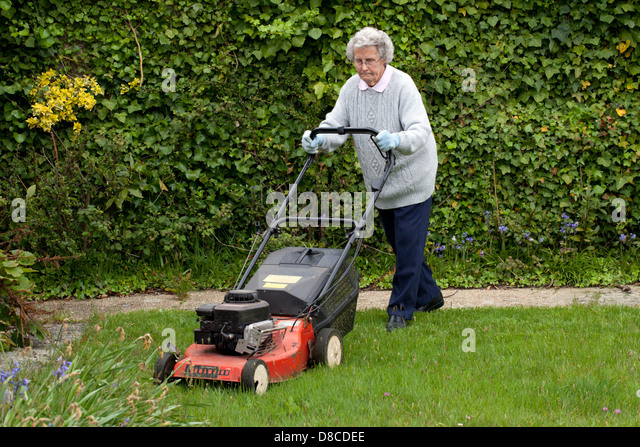 Mowing lawn uk stock photos mowing lawn uk stock images for Lawn mower cutting grass