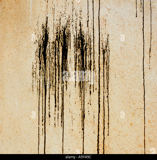 black paint on yellow wall - Stock Image