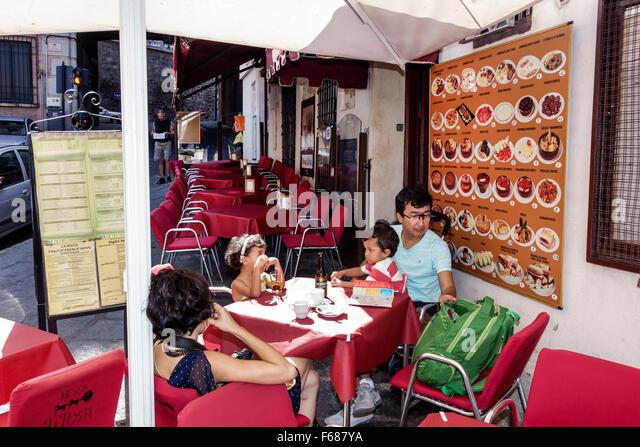 Spain Europe Spanish Hispanic Toledo historic center restaurant business sidewalk cafe alfresco family - Stock Image
