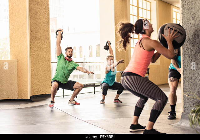 Group of adults doing workout - Stock Image