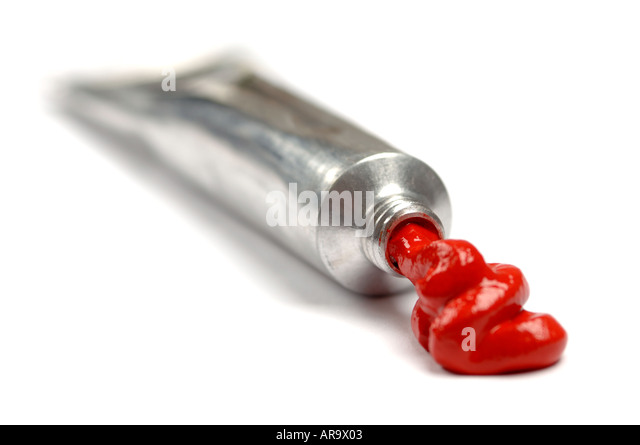 Tube of red artist acrylic paint - Stock Image