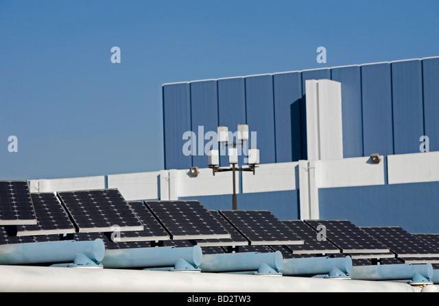 Solar panels in cityscape - Stock Image