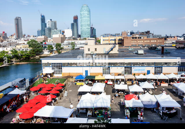 New York New York City NYC Queens Queens Long Island City LIC Flea & Food outdoor market vendors booths stalls - Stock Image