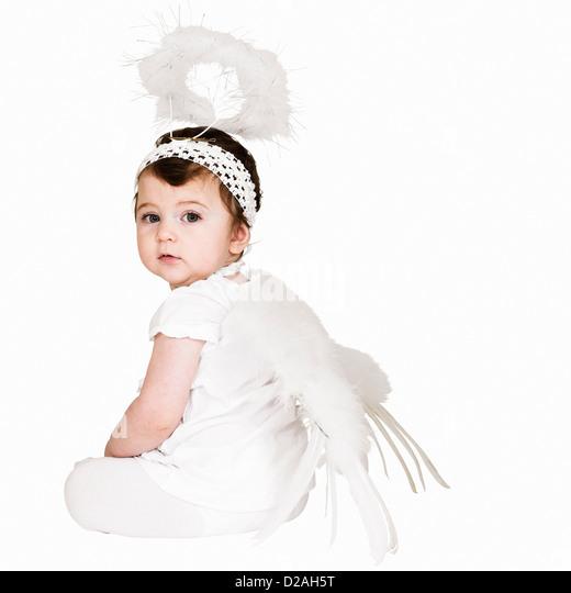 Toddler girl wearing angel costume - Stock Image