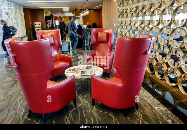 New York City NY NYC Queens LaGuardia Airport LGA inside terminal concourse gate area American Airlines Admirals - Stock Image