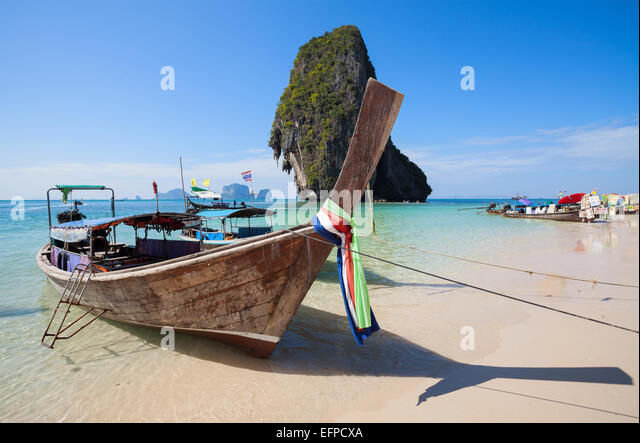 Wooden boats on the Railay beach, Thailand. - Stock Image