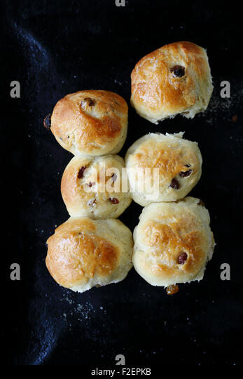Tasty buns with raisins. Sweet food - Stock Image