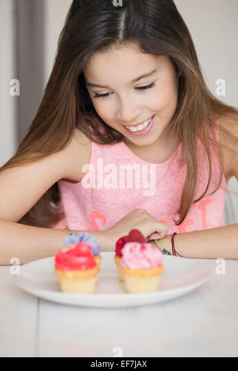 Happy girl with cupcakes - Stock Image