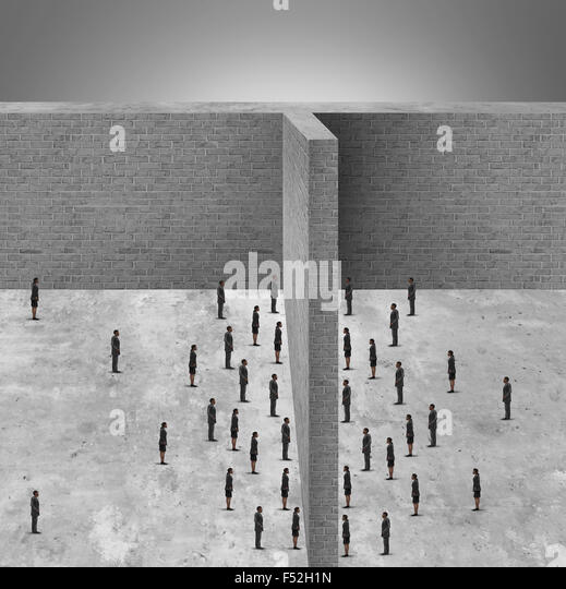 Barrier to business and restricted access to people due to a brick wall obstacle blocking communication and detached - Stock-Bilder