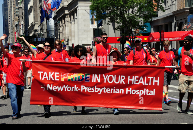 NYC: Health care workers from New York-Presbyterian Hospital marching behind their banner at the 2014 Gay Pride - Stock Image