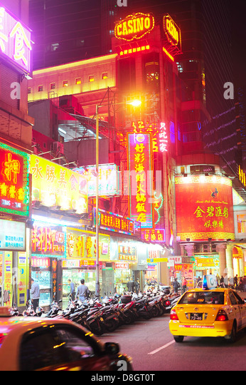Macau street at the evening. - Stock Image