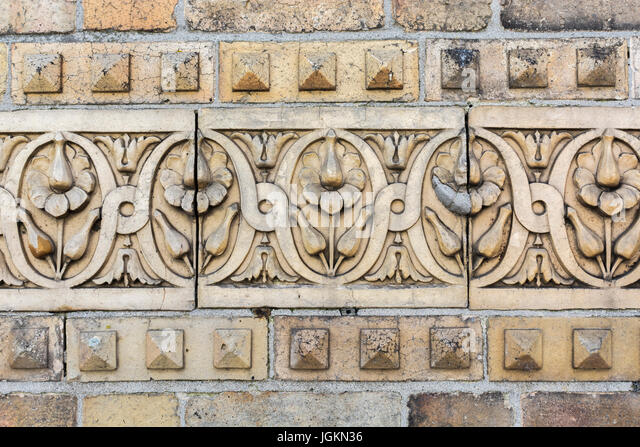 Victorian terracotta floral external brickwork on a building in Newquay, Cornwall. - Stock Image