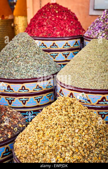 Ceramic pots of dried flowers, rose petals, buds and herbs in the souk. Morocco - Stock Image