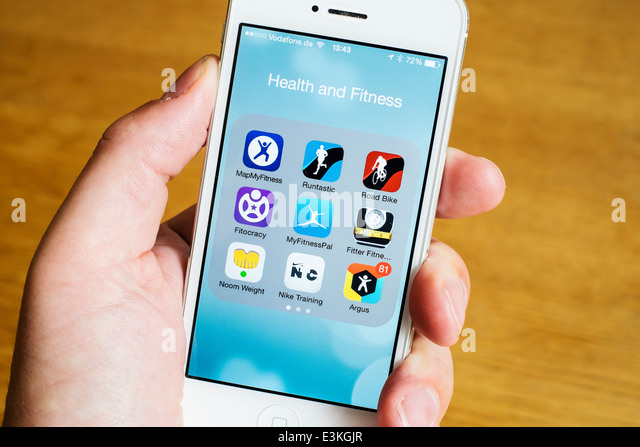 Detail of many health , sport and fitness apps on a iPhone smart phone - Stock Image