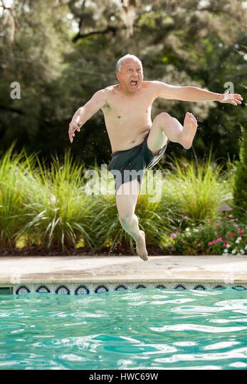Senior playing in pool - Stock Image