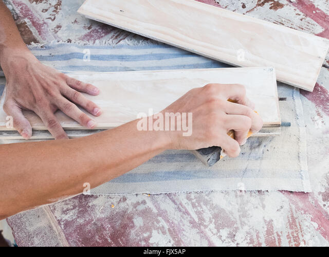 Cropped Hand Of Carpenter Working At Workshop - Stock Image