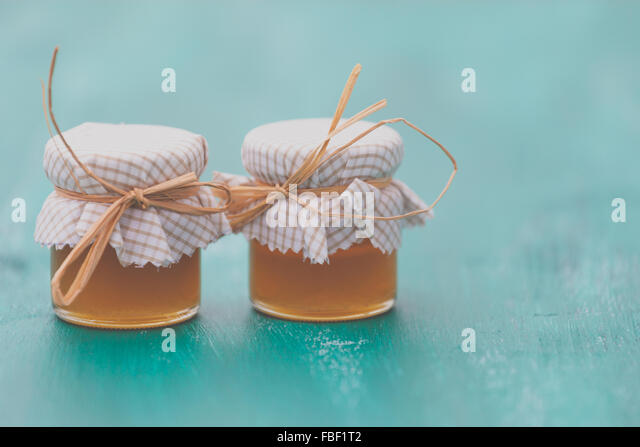 Honey In Containers On Table - Stock Image