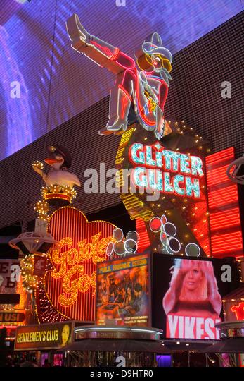 Nevada Las Vegas Downtown Fremont Street Experience pedestrian mall night nightlife neon signs Vegas Vicky Glitter - Stock Image
