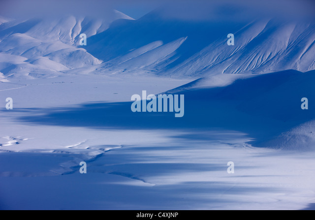 the Piano Grande in winter, Monti Sibillini National Park, Umbria, Italy - Stock Image