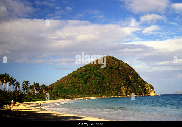 British Virgin Islands Tortola Long Bay deserted beach green hill blue sky background caribbean islands - Stock Image