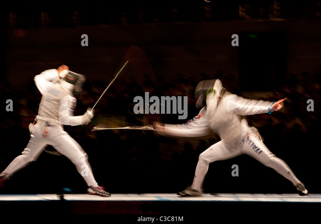 Blurred action of women's fencing competition at the 2008 Olympic Summer Games, Beijing, China - Stock Image