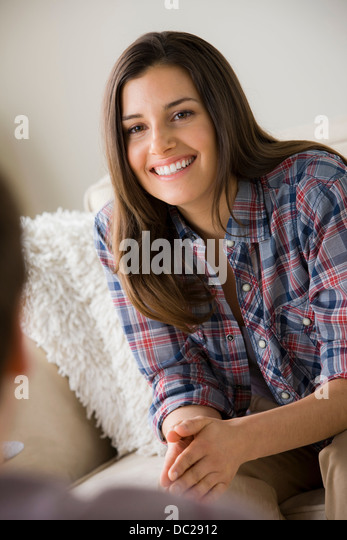Young brunette woman wearing checked shirt - Stock-Bilder
