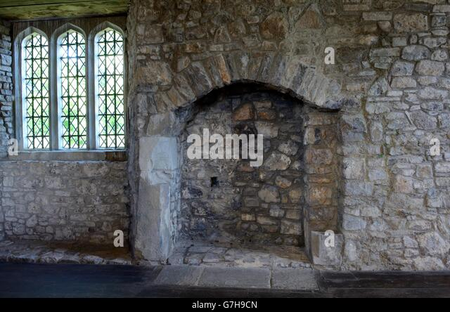 old stone fireplace. Old stone fireplace and window inside Oxwich Castle Gower Peninsula Wales  Stock Image Stone Interior Photos