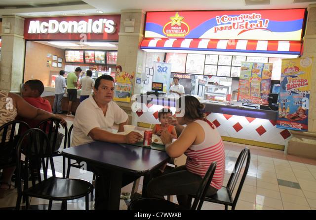 Managua Nicaragua Metrocentro shopping center centre mall food court chain restaurant McDonald's Pollo Estrella - Stock Image