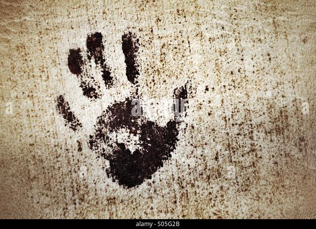 Small hand imprint on the pavement - Stock Image