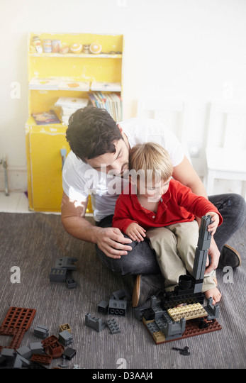Father and son building with blocks - Stock-Bilder