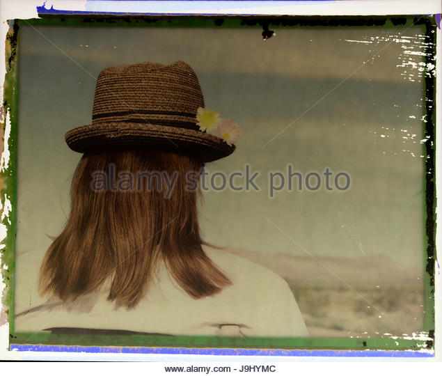 Polaroid transfer portrait of a woman in Death Valley National Park, California. - Stock Image