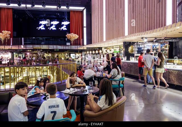 Spain Europe Spanish Madrid Recoletos Salamanca Calle de Goya Platea Madrid shopping food court converted movie - Stock Image