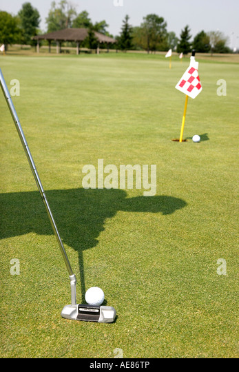 Toledo Ohio Oregon Maumee Bay State Park Scottish Links Golf Course putter ball practice green - Stock Image