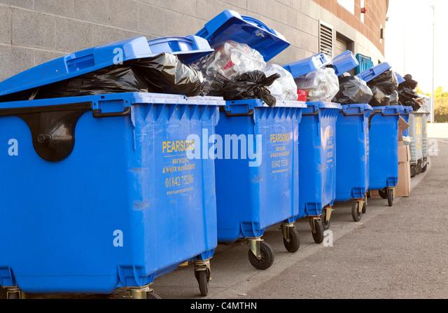 overflowing waste bins - Stock Image