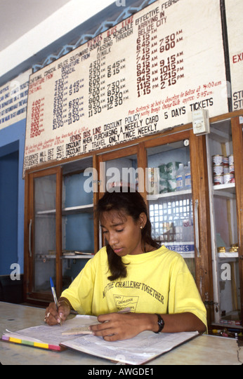 Belize Central America Corozal public bus station teen employee information desk - Stock Image