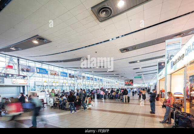 Passengers at Santiago Airport. Santiago de Chile Comodoro Arturo Merino Benitez International Airport check-in - Stock Image