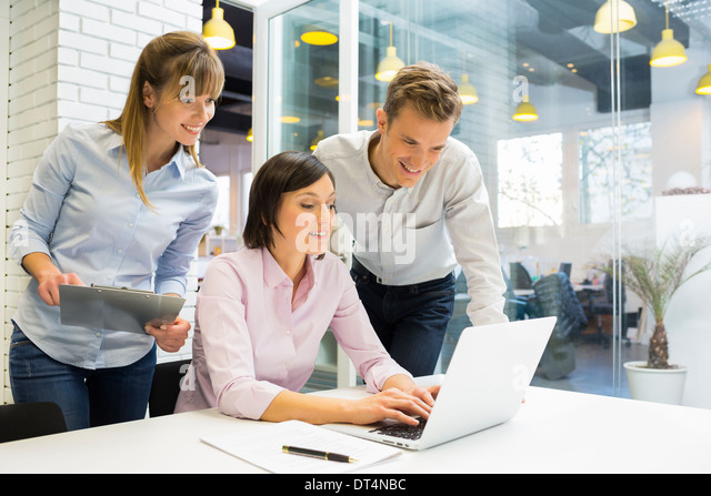 business man woman computer desk start-up - Stock Image