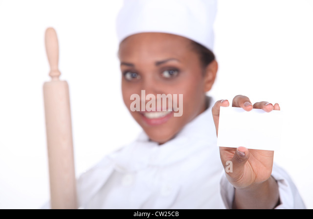 female chef holding business card - Stock Image