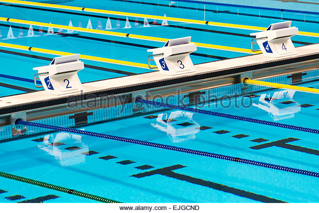 Beautiful Olympic sport competition swimming pool lanes in a clear transparent blue water facility - Stock-Bilder