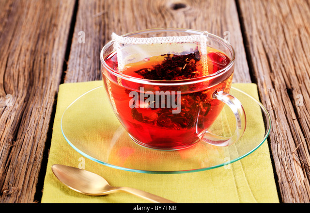 Fruit tea in a glass cup - Stock Image