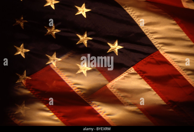 an american flag with one of the stars bleeding into the stripes - Stock Image