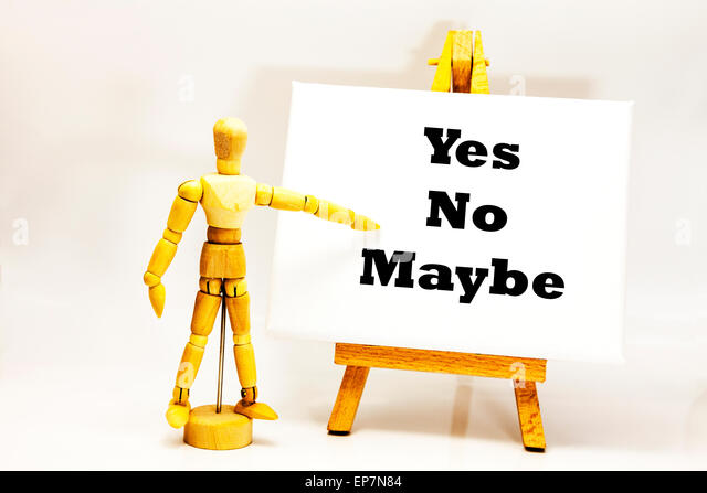 Wooden man with white board pointing at words 'Yes No Maybe' decision decisions choose choice pick picks - Stock Image
