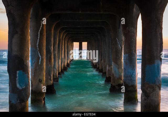 The Manhattan Beach Pier is a pier located in Manhattan Beach, California, on the coast of the Pacific Ocean. - Stock Image