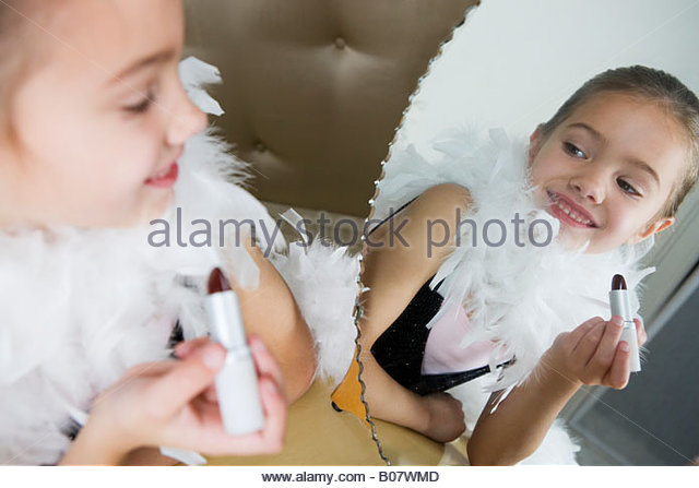 Young girl playing at dressing up - Stock Image