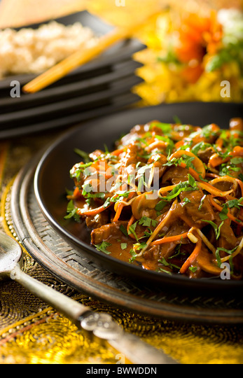 Thai Coconut Beef Stir-Fry with carrot, mushroom, and bean sprouts - Stock Image